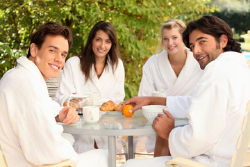 Friends having breakfast together outside