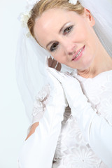 Closeup of a blonde woman in a wedding gown