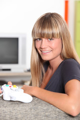 Blond teenage girl with video game controller