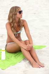 beautiful young blonde sunbathing at beach