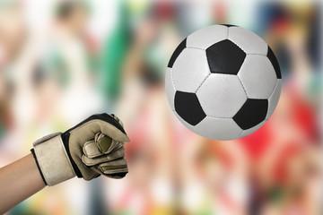 Ein Hand schlägt den Ball