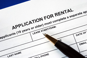 Signed the rental application with a pen