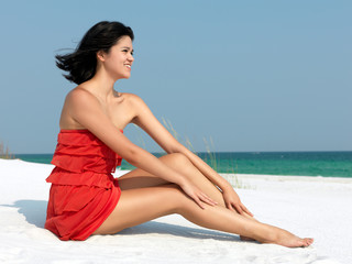 Happy Woman Relaxing on Beach
