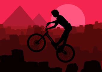 Mountain bike trial rider in Egypt pyramid ruin landscape