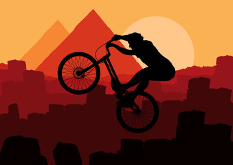 Mountain bike trial rider in Egypt pyramid ruin landscape
