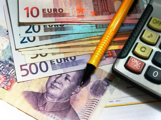 calculator and cash, money