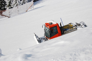 Sideview Of Snowcat Moving Downhill