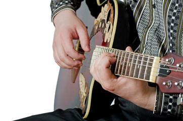 The man plays an electric guitar