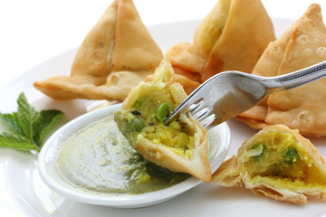 potato samosa with fresh mint dipping sauce , indian food