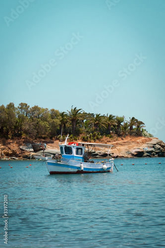 Fishing boat near the coast of the sea
