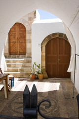 Portal white with wooden doors
