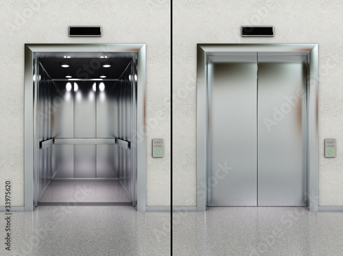 Open and closed elevator in lobby - 33975620