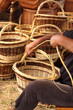 Details of the manufacturing of wicker baskets by a man