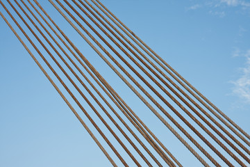 Set of steel cables against a blue sky
