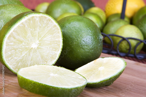 Sliced and whole Limes closeup background