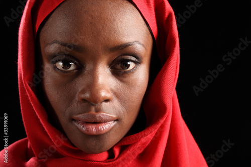 Headshot beautiful black african woman in hijab