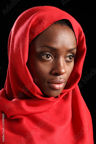 Religious african amercian woman in red headscarf