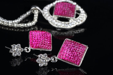 Pink Colored Jewelry Set with Earrings in focus
