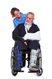 Nurse and injured man in wheelchair isolated