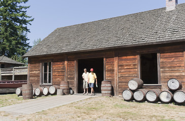 Log Cabin with Tourists and Barrels