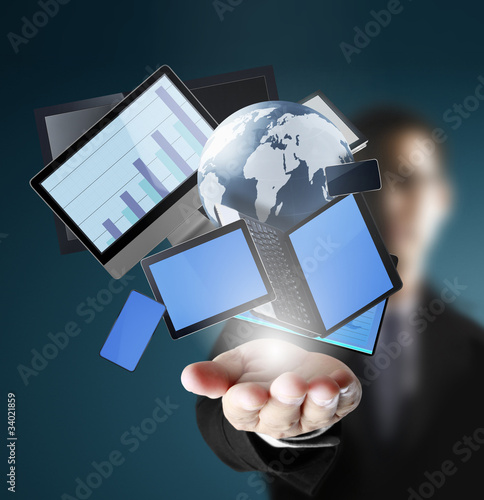 Mobile phones and laptops in hand