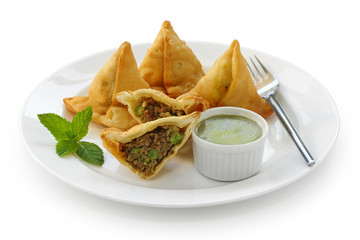 keema samosa with fresh mint dipping sauce , indian food