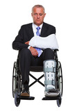 Injured businessman in a wheelchair isolated