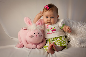 Baby Girl Leaning on Pink Easter Bunny Basket
