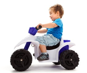 Little boy going fast with quad