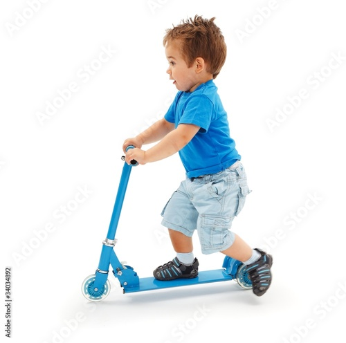 Boy playing with blue toy scooter