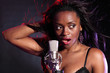Beautiful black girl makes music singing on stage