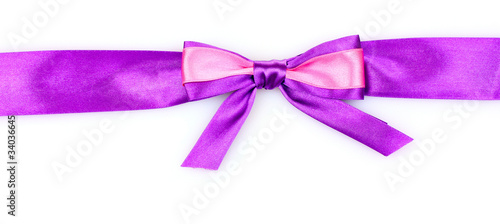 Purple  ribbon and bow isolated on white background
