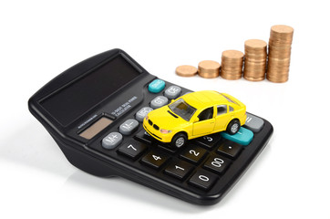 Calculator,coins and toy car