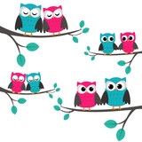 Fototapety Four couples of owls sitting on branches.
