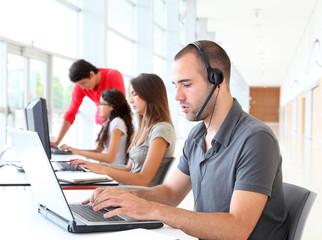 Customer service employee with headphones on