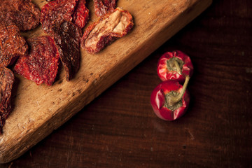 sun-dried tomatoes on wood cutting board
