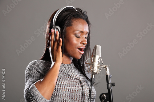Making music beautiful black woman singing in mic
