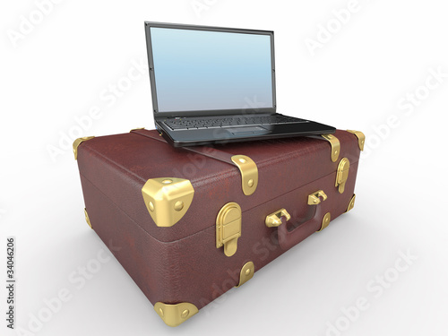 Laptop and suitcase on white isolated background