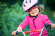 Adorable girl in pink safety helmet