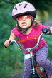sporty little girl with bike