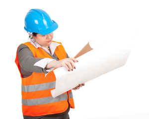 fat female architect or engineer reading blueprints, series