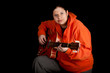 overweight, fat woman playing on orange electric guitar