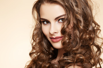 Beautiful woman model with ringlet hairstyle and bright make-up