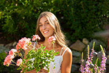 Garden in summer - happy woman with flowers