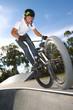 Freestyle BMX rider doing a trick