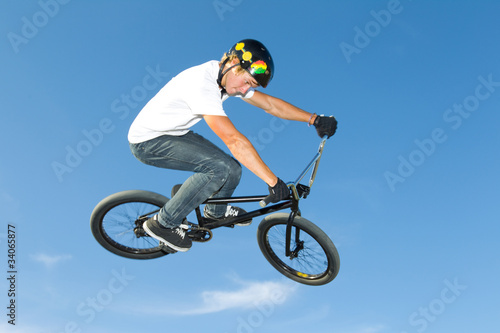Freestyle BMX rider getting air