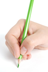 Hand writing with green pencil