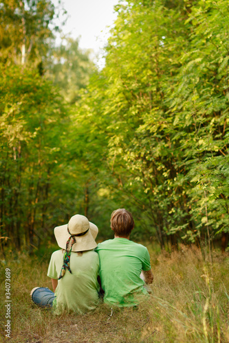 relaxation of young couple in the forest