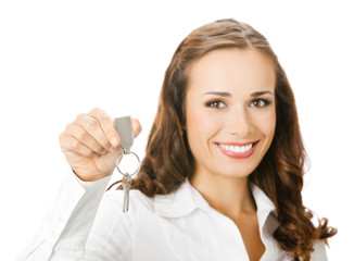 Business woman showing keys, focus on keys, on white