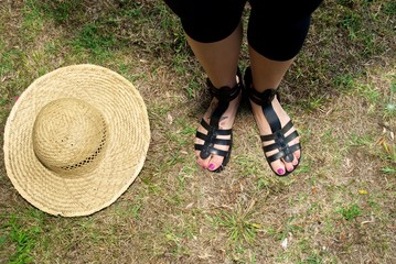 enslaved hat of straw and sandals